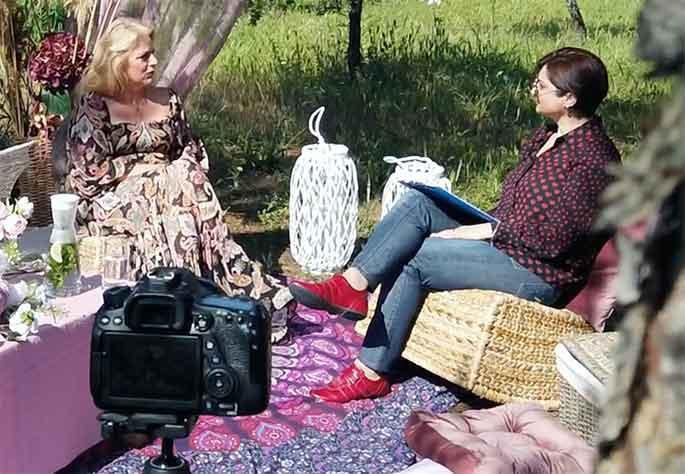 Miranda Tringis of CyHerbia being interviewed behind the scenes